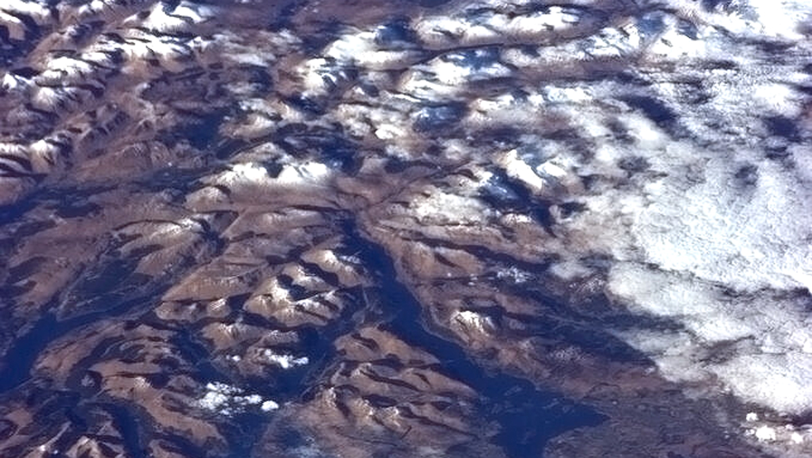 Snowy hills and lochs north of the Firth of Clyde from the International Space Station