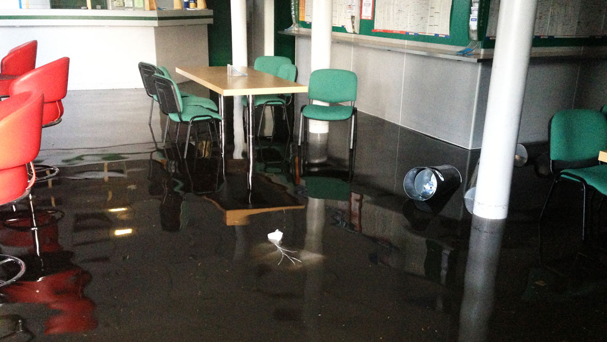 Bookmakers shop in Greenock flooded during deluge