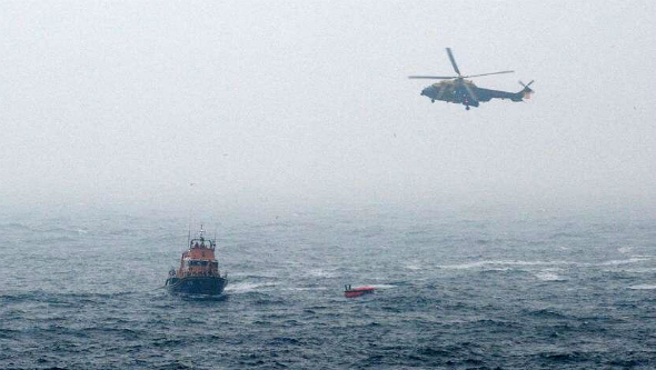 A lifeboat and rescue helicopter search the waters off Shetland on Friday night