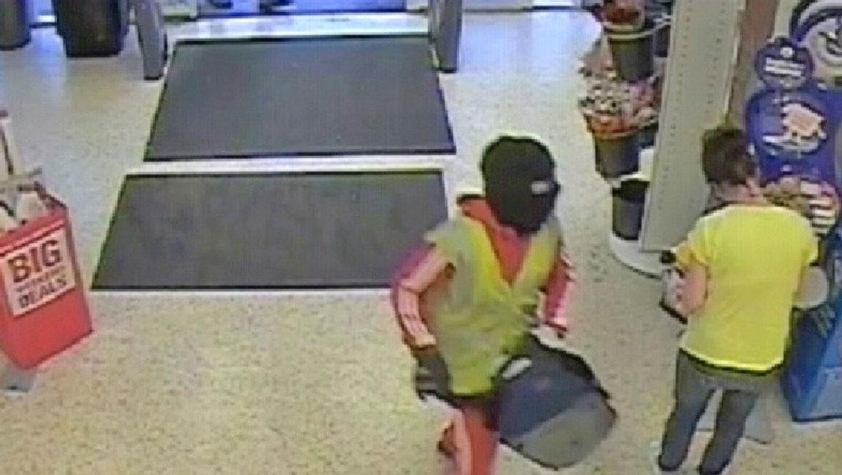 CCTV of spear gun robber Nikolas McGregor in Co-op, Hamilton