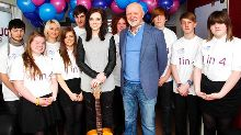 Amy and Sir Tom Hunter meet the Pulse Radio volunteers